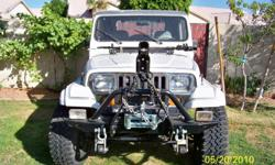 Jeep has;A rebuild 6 cyl. only 8,000 miles only.  Good air Cond.
