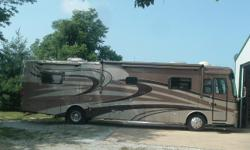 lots of extra's 400HP Cummins engine, Roadmaster Chassis with 8 bags. 4 slides, like new, ceramic tile floor from entry to bedroom, surround sound entertainment outside as well as inside. Stainless steel 14'refrigerator and freezer with ice