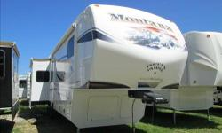 2012 Montana fifth wheel, model 3700RL. 3 slides Hickory Edition Made For Full Time Living. Tons of Storage, Only Towed 400 Total Miles. Like New, No Smoking, No Pets INTERIOR FEATURES: Vinyl Floors, Carpet, Corian Counter Tops, Full Kitchen, 4 Door