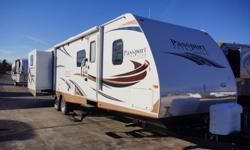 The 2014 Passport Grand Touring 3290BH is a travel trailer that has three slides with two of them found in the rear. A bunkhouse model, this RV has one rear slide with bunks over bunks on both sides. This particular model comes with Parsley interior décor