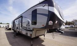 The 2015 Silverado 37QBS is a bunkhouse fifth wheel that has five slides and manufactured by Heartland RV. The Buckskin interior décor creates a luxurious inside. The Buckskin interior décor creates a luxurious inside. Enjoy a kitchen that comes with a