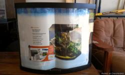 26 gal. Bowfront Aquarium Starter Kit. Includes: Full Fluorescent Hood, Submersible Heater, QuitFlow Filter, Fish Food Starter Pack, Water Conditioner Starter Pack, and Setup & Care Guide.