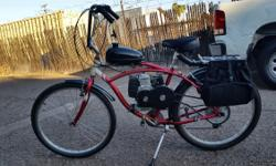 Have a 4 stroke chain drive 48cc mounted on a schwinn cruiser for sale for $350.00. In reliable condition and all funtions. has new tires, seat motor, grips. Has a set of panniers on for trips to the store or? Can legally ride without a licence needed so