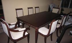 This 4?-ft by 8-ft rectangular table and 8 chairs are in excellent condition. We?re selling them because it was never used and we?re converting the room into a home gym