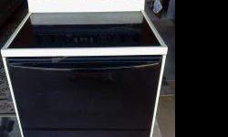 Amana4burner flat surface stove. Great working condition and very clean.Self cleaning,Located in Mesa.