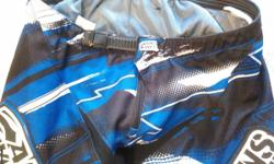 Men's Answer Syncron pants Sz.34 blue/white Worn 4 times then sold bike. Excellent condition .Bought new in 2013 for $180.00. No rips ,no no snags, no scuffs (I know how to ride) lol