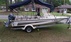 16' Cobia with 60 hp Evinrude motor . Runs great. Galvanized drive on trailer , new trolling motor, 2 way radio, Am/Fm CD player, 2 canapy tops, 13gallon seat gas tank. Great flatsand freshwater and recreational boat. I paid