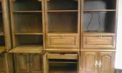 """Book Case with Storage ...( 7) seven units available,Adjustable shelves, Back light, Solid oak, Deminsions 76"""" high, 30"""" wide, 18"""" deep. Picture shows three of the units."""