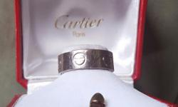 1. Brand: Cartier 2. Metal: 18K White Gold 3. Ring Size: 56. US Size 7.5. UK Size 0 1/2 4. Internal Diameter: 17.85 mm 5. Measurement: .02 mm Width 6. Condition: Excellent 7. Signatures: Cartier, 750, 56, 161755 8. Additional notes: It comes with the box.