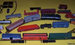 18 model train cars individual or together. Southern Pacific Engine with box 4 curved track 2 changer track 1 dead end track 1 TYCO hobby transformer 2 tracks, 2 accessories with wires. 1 red letter sign box -$50.00