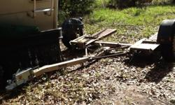 Used but WORKS WELL, ALL NEW SURGE BRAKE SYSTEM, NEW HITCH, 2 new tires, includes tie-down straps and spare tire