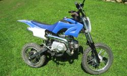 110CC 4 STROKE DIRT BIKE-BLUE/WHITE, 6.39 HORSEPOWER, GREAT CONDITION, SELDOM USED