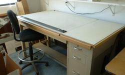 """Hamilton drawing table, 72"""" x 38"""" with 4 drawers, tilting top with parallel rule. Included is an adjustable, upholstered stool with back Asking $125 for both."""