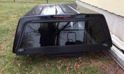 I no longer have a use for the truck cap and would like to sell it. It has a drop down front window with inside light and brake light and locking exterior handles. Cap will fit most midsize trucks