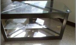 """GLASS TV STAND LIKE NEW!!!!NO SCRATCHES!!!! GLASS AND BLACK.. HOLD UP TO 42""""TV!!!!PERFECT CONDITION...."""
