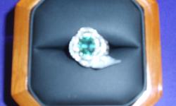 This is a stunning 3.64CT mint tourmaline circled by .70CT VS diamonds in an 18K white gold setting. A $135 GIA certification and the original purchase receipt is included in the price. My wife passed a few years ago and I'm selling this at a fraction of