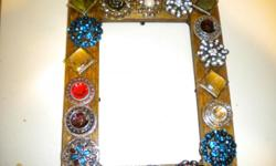 Handmade mirrors/picture frames. I can make them in the color of your choice. Email me for further info. Thanks.