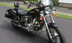 One owner, garage kept with only 12,000 miles. Black, molded saddlebags, windshield. light bar, backrest with rack. Shaft drive, water cooled. Crystal Lake, IL  847-309-3698