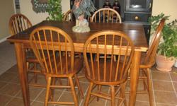 Tall kitchen table like new-asking $600.00-table has a large leaf tucked away inside of table! Couch & Love seat Tan excellent condition-$600.00 Can email pics at buyers request!