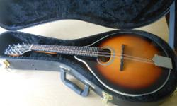 Savannah Mandolin , hard shell premium case, tuner and primer book with cd. barely used, due to arthritis becoming worse. 402-506-1614