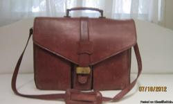 This preowned Maraolo leather bag has many pockets for cell,pens,laptop etc. The color is brown. contains 5 pockets.