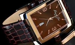39 mm wide and 9 mm thin rectangular case, 22 mm wide brown calfskin leather strap, precise Japanese quartz movement, luminous hour and minute hands, brown dial, second hand, date at 6 o'clock position, water resistant to 100 feet, call 363-6565