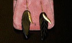14k yellow gold natural onyx untreated feather earrings. $75. 267 Kenmore Ave. 11am-7pm mon-fri 12pm-3pm sat-sun (716) 783-7853