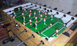 This used soccer game table is built with style and comfort in mind. Large, solid, rubber grips allow for comfortable handling during play, and the cabinet is a smart looking light butcher block finish that is sure to blend into your game room's décor.