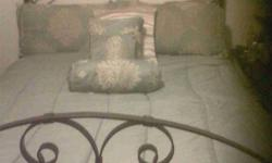 Wrought Iron Queen Size bed with headboard and foot board