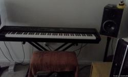 """FOR SALE Roland RD700SX Digital StagePiano and 2 Roland DS90 Studio Monitor speakers includes a """"on stage"""" piano stand,cables and damper pedal has servicable stool.Great sound, near mint condition. everything you need to set"""