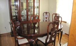 This elegant dining set was made by the Stanley Furniture Company. If you want to see how this company makes furniture, go to stanleyfurniture.com. The chest of drawers is over 5 ft. wide and about 21/2 ft. hight as the hutch sits on top. The hutch is