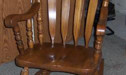 This solid oak rocking chair is made in the USA. It's very rugged, durable, and extremely comfortable. You can call me at:716-675-5516, or email me