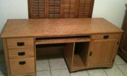 Oak wood desk; large enough to accommodate computer w/multiple screens, printer, scanner, tower; has a slide out keyboard drawer and 4 drawers to place office supplies, hanging folders, CD's, DVD's and most anything you need. Excellent for the busy