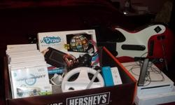 THE WII GAME AND 15 GAMES. HAS 2 CONTROLS,THE  WHEEL CONTROL,2 MIKES, AND THE WII DRAW, AND THE GUITAR.. AROUND 800.00 OF STUFF. SELLING FOR 325.00 WORKS GREAT. AM IN FAYETTEVILLE AR.    --