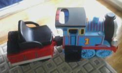 thomas the train ride on. includes figure eight track and expansion track valued at $200.00. also included ride through tunnel. contact -- or --