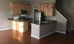 Downtown Walled Lake loft. Contemporary feel in a modern building... 1352 sqft... 3 rooms upstairs w/ 9ft ceilings: 2 bedrooms,walk-in closet in masterplus an additional study/ library/office space. OPEN FLOOR PLAN, private 1 car garage, 1st