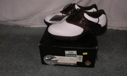 Brown & white leather saddle shoe, never worn, still in the box, rubber spikes, size 10 W, $25.00.